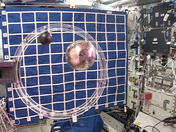 2 balls in circular track air resistance